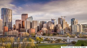calgary city skyline with center street bridge and bow river